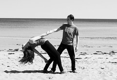 Dancing in the Sand (sarah-sari19) Tags: april spring outside outdoors daylight sunlight naturallight people person human beach sand water ocean shore sea man boy handsome girl woman blackandwhite monochrome greyscale dance couple together dip trust curls curlyhair