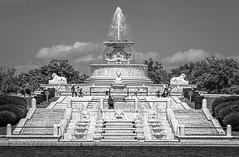 Fountain View (Wes Iversen) Tags: bellislepark belleisle detroit fencefriday hff jamesscottmemorialfountain michigan blackandwhite fence fountains monochrome people stairs water