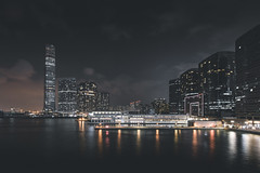 Kowloon West Skyline (Jan Senderek) Tags: sony sonyalpha a7r a7rii a7r2 nikon wide angle nikkor 1424mm f28 fotodiox adapter hong kong hk hkg skyline skysc skyscrapers buildings tall night long exposure low light availablelight dark moody agameoftones bay water ships lights neon chin china kowloon view