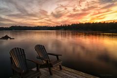 A Warm September Evening (Lindaw9) Tags: sunset lake adirondack chairs dock shanty bay westarmoflakenipissing northern ontario scenery treeline