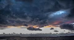 Over the sea to Skye , and Eigg. (AlbOst) Tags: sunset scottishhighlands scottishcoastlines mallaig islands scottishislands skye isleofskye eigg clouds