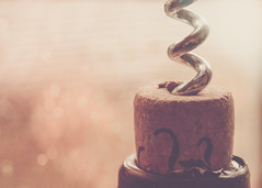 ~Wine is bottled poetry. (Fire Fighter's Wife) Tags: spiral wine cork bokeh metal hazy haze hmm macro macromondays happymacromonday olympus 1250mm 1250mmf3563 blackinkwine closeup light softcolors softhues softhaze softlight faded fadedcolors fadedhues muted mutedcolors mutedshadows dreamy drink beverage