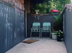 positive-thoughts (kaumpphoto) Tags: chair mamiya 120 patio minneapolis street urban city mat brick teal chalk grill lounge relax leisure