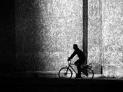 Biker (Sandy...J) Tags: blackwhite bw black bike bicycle biker light street streetphotography sw shadow monochrom man alone city contrast cyclist noir urban white wall germany olympus silhouette