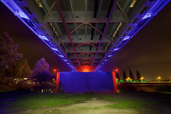 Onder de John Frostbrug (zsnajorrah) Tags: urban bridge overpass industrial architecture symmetry trees led illumination lightpainting lateevening night sky clouds longexposure ultrawideangle uwa 7dmarkii efs1018mm netherlands arnhem johnfrostbrug johnfrostbridge eenbrugtever abridgetoofar