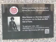 Vote for Nina Simone! (crochetbug13) Tags: crochet crochetbug olek loveacrosstheusa raleighconventioncenter raleigh northcarolina ninasimone yarnbomb yarnbombing crocheted crocheting redheartyarn redheartsupersaver pink orange