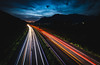 Long way home (Toukensmash) Tags: sky dark blue red street long exposure cars car highway from above styria österreich austria leoben sunset setting sun sigma1020 sony alpha58 way home motion mountains valley transportation high evening night light trail cloudy driving lights
