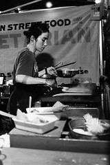 Indian street food (sam.naylor) Tags: london black white monochrome film 35mm pentax negative fomapan 400 street food people server culture evening moody takeaway eating chef cook meal
