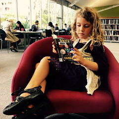 Reading about her namesake. Southport Library.