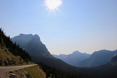 Slow down and enjoy view while driving (daveynin) Tags: sun nps montana mountain mountains scenic cliff sky clear