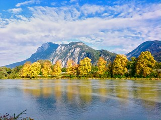 River Inn and Zahmer Kaiser mountain at the beginning of autumn in Tyrol, Austria