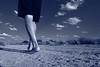 Giant (em_burk) Tags: canon arizona people desert man solitary walking wilderness walk summer monochrome blue sky bluesky clouds feet legs road gravel textures ciel portrait