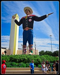 Big Tex (PEN-F_Fan) Tags: dallas tx unitedstates texas statefair fairpark raw sky clouds microfourthirds olympus12100mmf40pro olympuspenf bigtex icon on1photoraw beta postprocessing people building