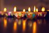 Diyas (Clay lamps) (KennardP) Tags: diyas deepavali devali hindu claylamps diwali canon5dmarkiv 5dmarkiv sigma50mmf14dghsmart sigmaartlens sigma canon lights colors festivaloflights holiday hindufestival oillamps