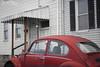 Street Beetle (Hi-Fi Fotos) Tags: vw volkswagen bug beetle vintage german classiccar red old antique used street parking rowhouse city urban pittsburgh nikkor 50mm 14 nikon d7200 dx hififotos hallewell