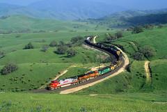Rainbow of paint schemes (Moffat Road) Tags: bnsf freighttrain curve tehachapimountains ge dash9 c449w warbonnet bealville california tehachapipassroute locomotive ca