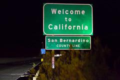 eight more hours still to go (ezeiza) Tags: california ca interstate40 interstate highway 40 i40 needlesfreeway needles freeway westbound night roadside sanbernardinocounty san bernardino county welcomesign welcom sign guardrail guard rail