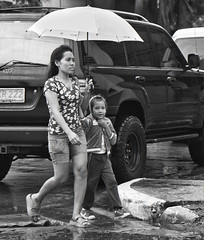 Smile (Beegee49) Tags: mother daughter walking rain smile bacolod city philippines