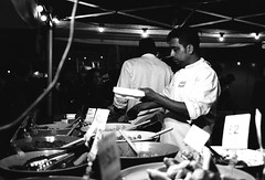 Street food (sam.naylor) Tags: london black white monochrome film 35mm pentax negative fomapan 400 street food people server culture evening moody takeaway eating chef cook meal