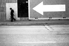 perfect strangers down the line (cHr1st1an S images) Tags: konicac35ef konicac35 konica35ef konica35 konicaef konica35mm film negative negativefilm bianco nero black white biancoenero blackwhite bw rodinal rodinalsemistand semistand 35mm film35mm nophotoshop 35mmfilm confused man boy people moto motion movement bird birds light bokeh blur natural sunlight dream dreaming hair misty wind adumbrations adumbration waves storm murales graffiti poster posters art streetart shadows fresh drama wave streetphotography street city soho malaga andalucia spain flickr chr1st1ans christiansorrentino