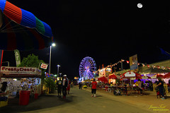 Turkey legs, fried Twinkies, and ferris wheels (Justitia Omnibus) Tags: arizona art amazingshot landscape canon canonphotos canonusa city red perspective perfectioninphotography leaveyourmark foto fair carnival night nightphotography light justgoshoot sky moon phoenix photography usa waycoolshots blue