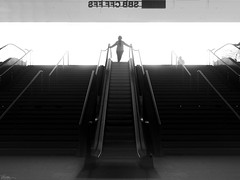 Here She Comes (René Mollet) Tags: comes woman blackandwhite escalator stairway street streetphotography silhouette shadow streetart station streetphotographiebw sunrise urban urbanstreet monchrom candite backlight renémollet