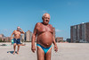 Bathing Buddhas (Gisele Duprez) Tags: brightonbeach speedo beach nyc streetphotography fujifilmx100f