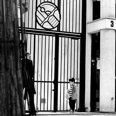 In front of the big portal (pascalcolin1) Tags: paris13 homme man enfant child père father portail portal lumière light photoderue streetview urbanarte noiretblanc blackandwhite photopascalcolin 50mm canon canon50mm