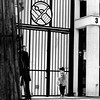 In front of the big portal (pascalcolin1) Tags: paris13 homme man enfant child père father portail portal lumière light photoderue streetview urbanarte noiretblanc blackandwhite photopascalcolin 50mm canon canon50mm
