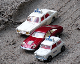 Dinky Policecars chase Corgi Marcos Mantis