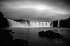See, why photographers love to go to Iceland... (_Amritash_) Tags: iceland blackandwhite longexposure longexposurejunkie rocks waterfall godafoss photographers silhouetteofaphotographer travel clouds weather monochrome monochromemadness