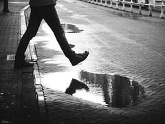 the next step can go wrong (René Mollet) Tags: puddle step man street streetphotography shadow silhouette streetart streetphotographiebw schwarzweiss renémollet urban urbanstreet candite penf blackandwhite bw