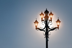 Shining lamps on blue sky with sun (jack-sooksan) Tags: post pole lamp lantern light silhouette shine bright day sun sunlight blue dark sky orange warm hot blazing radiant beam gleam sunshine lighting illumination glow