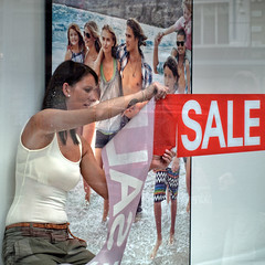 Splash! (Anne Worner) Tags: street streetphotography candid square woman windowdesigner sale poster people running splashing condensation window glass hot warm tanktop slacks longhair olympus anneworner earrings brunette youth youngpeople belt seethrough bra brassiere