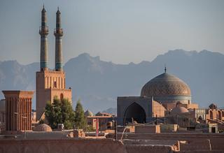 the sun sets over yazd, iran
