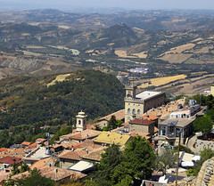 San Marino at the top Monte Titano (B℮n) Tags: monumento bartolomeo borghesi universityoftherepublicofsanmarino adriatic sea sanmarino cittàdisanmarino montetitano is land clifftop castlesis enigmatic mysteryis vertiginous views castle slopes mountain republic tourist vacation hills ridge viewpoint clifftops unesco panorama state visiting summer steep trees church palazzopublicco monte titano castellodellaguaita medieval stone wall rooftops 50faves topf50