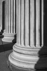 British Museum (cybertect) Tags: bloomsbury britishmuseum carlzeissplanart50mmf17 london londonwc1 robertsmirke sonya7 wc1 architecture blackwhite blackandwhite building classical column flute monochrome morning portico shadow