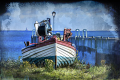 Lindisfarne Boat (Bobinstow2010) Tags: lindisfarne northumberland arty topaz photoshop sea harbour wall yard repair