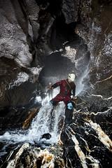 _DSC1519 (ChunkyCaver) Tags: cave caver caving spelunking stream water dark black white