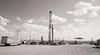 Oil Well In The Parking Lot (LostOzarkRambler) Tags: wyoming oilwell workoverrig gasstation monochrome blackandwhite nikond800 28mm