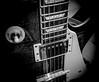 DSCF4519 (bc-schulte) Tags: xt20 fujifilm fujinon 1650mm bw nahlinse 4 epiphone saiten strings guitar gitarre pickup blackwhite