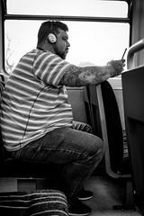 2017_292 (Chilanga Cement) Tags: fuji fujix100f xseries x100f bw blackandwhite monochrome man train tattoo tatoos ink headphones commuter commute commuters commuting phone squeeze window