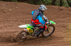 Kawsaki In The Turn (John Kocijanski) Tags: motorcycle motocross vehicle sport race rider people canon70300mmllens canon7d