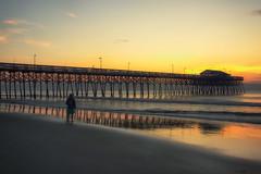 watching the sunrise (dorameulman) Tags: sunrise dawn gardencity southcarolina beach ocean pier people waves haiku canon7dmark11 seascape