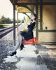 Waiting for the Train (Rachel.Adams) Tags: witch witchy halloween halloweenseries 31daysofhalloween broom flying levitation photoshop train lipstick glamour style halloweenportrait witchywoman magic magical spells suitcase travel traveling travelwitch floating stylish magicalphoto