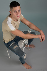 Dominic (PhotoMechanic.uk) Tags: male man guy dude youth model pose photoshoot boy studio jeans tshirt fashion trendy casual green blue chair foot feet barefoot sit sitting
