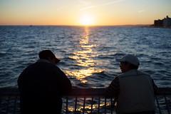 Fishermen (dtanist) Tags: nyc newyork newyorkcity new york city sony a7 konica hexanon 40mm brooklyn coney island boardwalk steeplechase pier sunset sea fishing fisherman fishermen