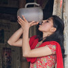 Thirsty (Dick Verton ( more than 12.000.000 visitors )) Tags: asia nepal travel vrouwen water thirsty red