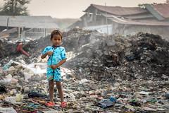 _DSC7537-2 (joshlphotography) Tags: poverty boy child kid trash pollution cambodia