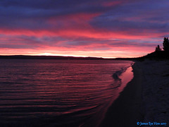 Great Lakes Sunrise (JamesEyeViewPhotography) Tags: northernmichigan michigan beach sky water greatlakes lake fall colors autumn jameseyeviewphotography sunrise clouds waves trees lakemichigan